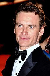 Michael Fassbender-- (born 2 April 1977) is a German-born Irish actor. His feature film debut was in the fantasy war epic 300 (2007) as a Spartan warrior; his earlier roles included various stage productions, as well as starring roles on television such as in the HBO miniseries Band of Brothers (2001) and the Sky One fantasy drama Hex (2004–05).