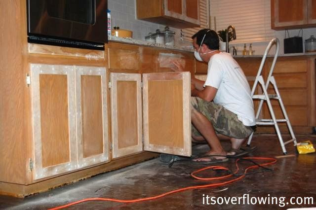 It's Overflowing blog; she refaced her kitchen cabinets for pennies compared to what it would be to rip them out. Kudos! <3