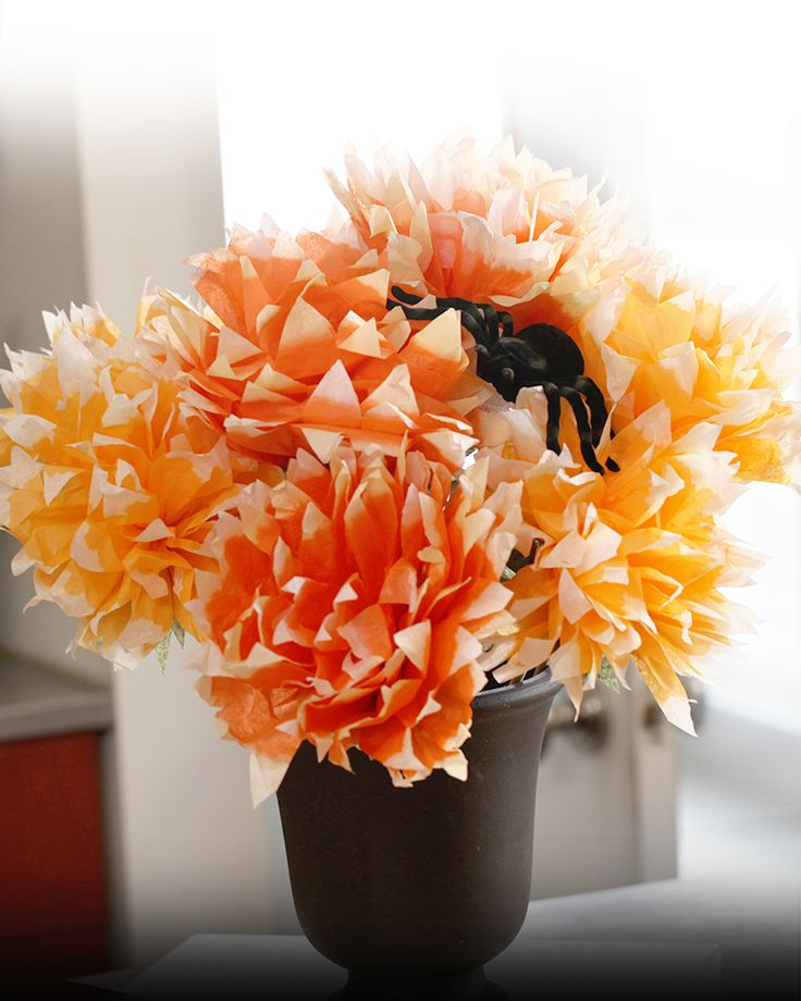 This paper floral centerpiece is what your Halloween party is missing! The bright orange petals add a pop of candy-corn color that will brighten your spooky table settings. For more DIY project ideas, subscribe to the Kin Community YouTube channel: http://bit.ly/BlogSubs