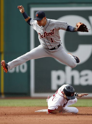 Detroit Tigers' Jose Iglesias (1) jumps after getting