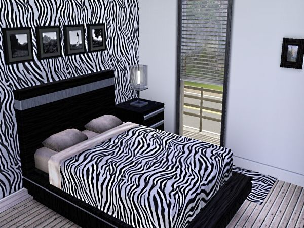 Zebra print bedroom - don't stare at for too long as it will make your eyes go funny.