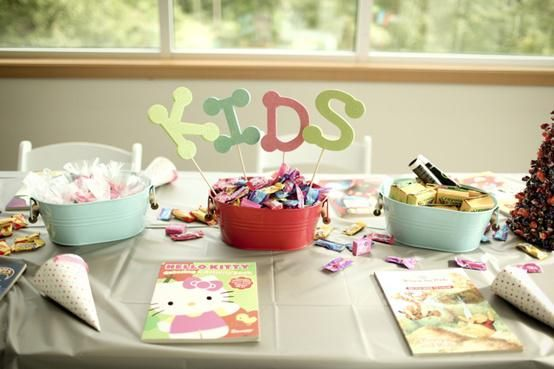 kids activities at wedding ( coloring books, games etc. stacked on treats table)