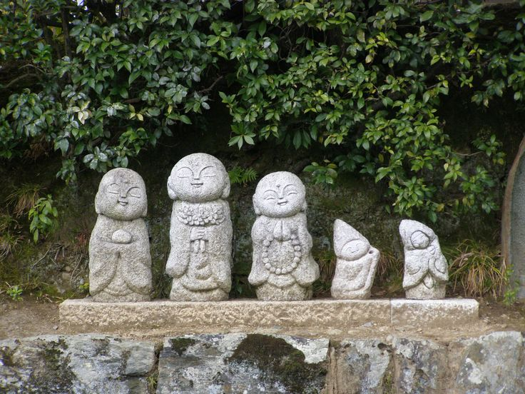 Jizoo, small stone sculptures, usually icons dedicated to the protection of children. These roadside ones in Kyoto are for the protection of pedestrians.