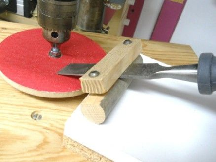 Drill Press Sharpening Jig by Bricofleur -- Homemade drill press sharpening jig constructed from a wooden dowel, a wood block, nuts, and bolts. http://www.homemadetools.net/homemade-drill-press-sharpening-jig