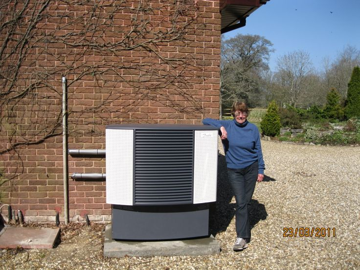 Our customer Mrs B. with her Danfoss Air Source Heat Pump in Ringwood Hampshire. Another successful installation by Poole based award winning renewables company NGPS Ltd.