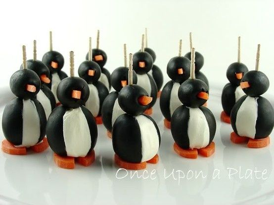 How adorable are these little party penguins? Just split one black olive down the center and stuffed it with cream cheese, the place another olive perpendicular on top to make the head, add carrot feet and beak, then a toothpick to hold it all together!