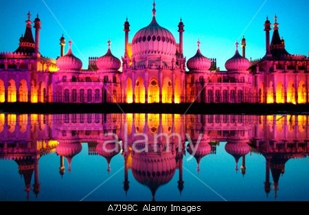 Brighton Royal Pavilion floodlit in Pink to celebrate the city s Gay Pride festival reflected in a pond © Roger Bamber / Alamy
