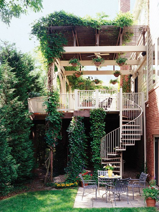 Spiral Staircase  A spiral staircase such as this one is a graceful and space-saving way to access an upper-level deck.