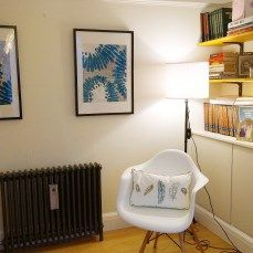Library sitting room in teal blues with a simple Ikea table runner cut and framed