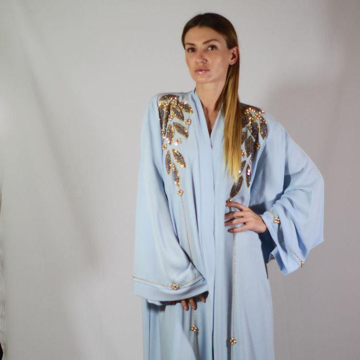 EID collection Abaya .  Hand work Swarovski . Color baby blue . Fabric - French Niddah grade 1 .  Price :  AED - 1200 USD - 350 EUR - 295 GBP - 225 SAR - 1225 KWD - 98