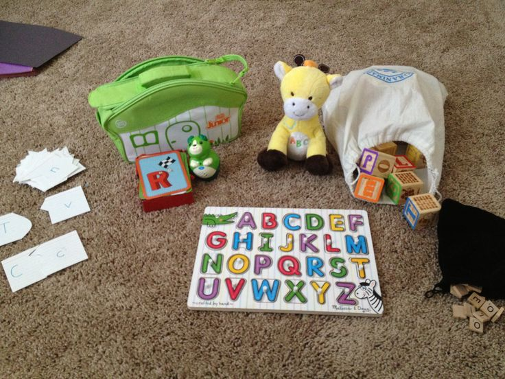LETTERS/PHONICS: - flashcards from 3x5 cards cut into puzzle shapes to match upper and lower case letters - Melissa & Doug wooden alphabet puzzle with pictures under letters - Leapfrog LeapReader™ Junior Interactive Letter Factory™ Flash Cards - Giraffe toy that sings the alphabet - wooden blocks - Scrabble tiles