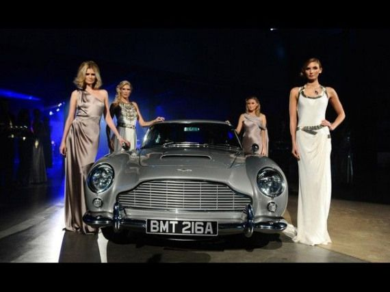 Girls Always Like Your Motor James Models Pose With An Aston Martin Db5 At The Skyfall Royal World Premiere Afterpar Aston Martin Aston Martin Db5 Model Poses