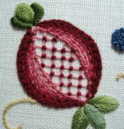 [Crewel Embroidery Pomegranate] I have this pattern somewhere...favourite bit is the stitching in the middle.