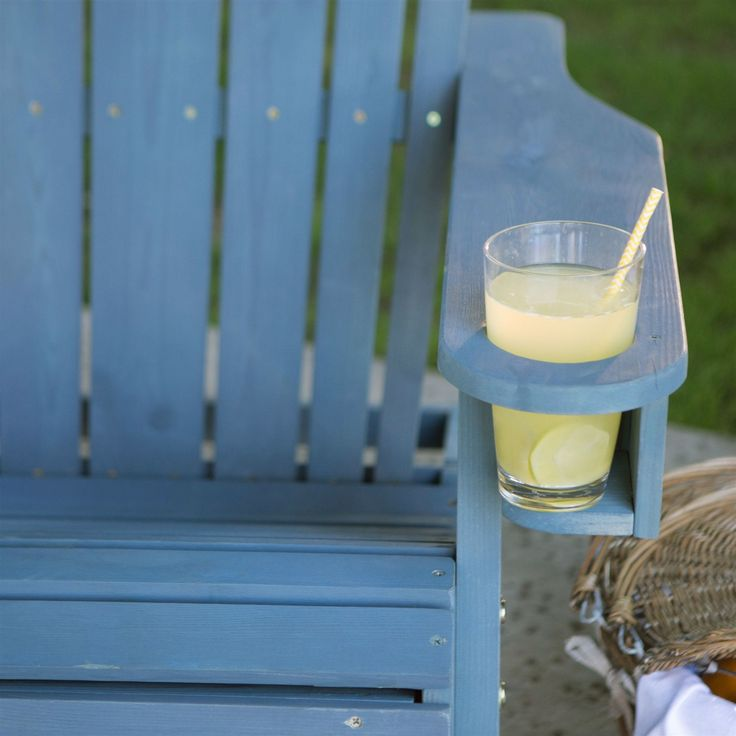 The classic lounge chair gets a modern update with this Blue-Stain Wood Adirondack Chair with Pull Out Ottoman and Built in Cup Holder. This isn't your typical Adirondack chair. Its ergonomic structur