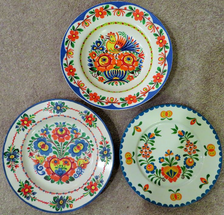 Hand-painted Czechoslovakian plates which belonged to by Grandparents. If anyone can give me any information about this traditional folk art-significance, meaning, please comment. I am very proud of my Czech heritage and would love to learn more. My Grandparents were from the Moravian region of Czech Republic.