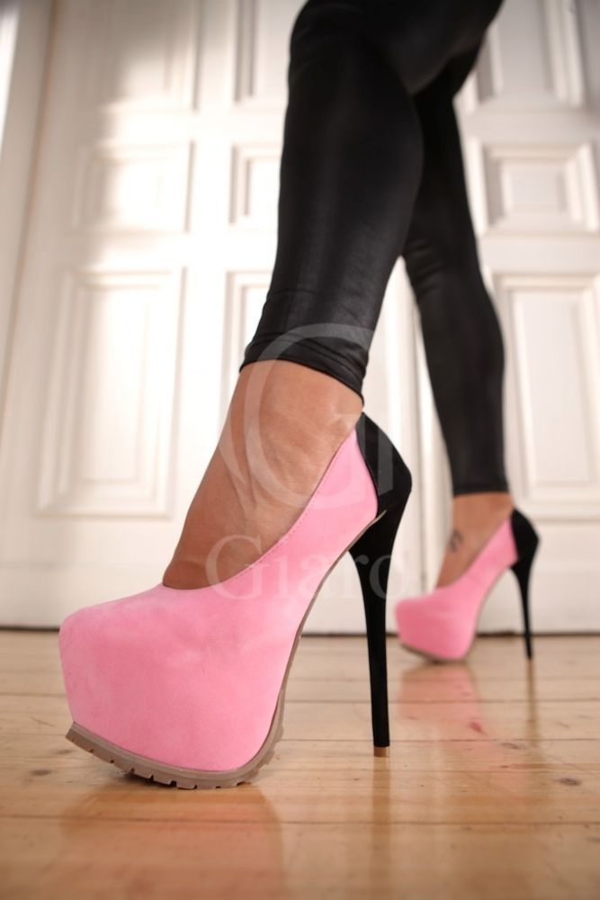 In your face pink and black platform. Can be warn to a casual luncheon or spice them up with a sexy little black play suit and hit the night out.