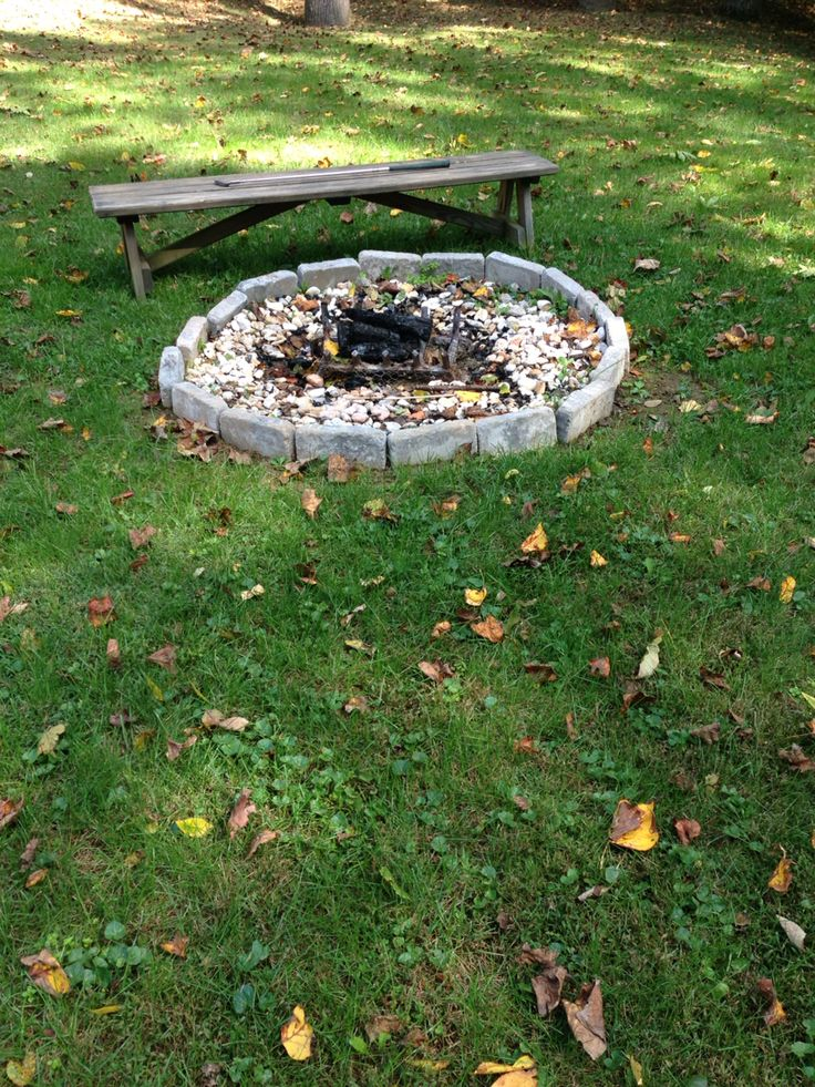 In this photo. You still cannot tell which is the focal point. Though the fire pit is in front and sort of in the center, the bench towers over it and making an appearance.