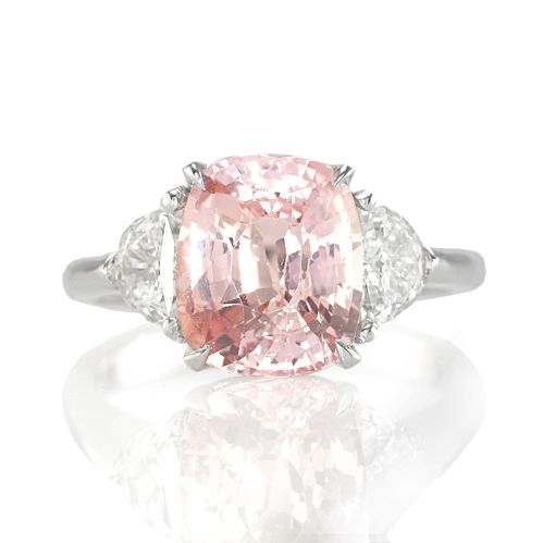the more i see these, the more i'd rather have this than a diamond....i love peach!