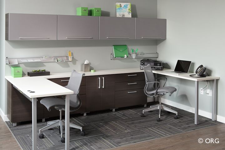 Office for two  There's room for two to work at home or at the office in this cleverly organized space. Flip-up storage cabinets, drawers with filing systems, wall organizers, and utility management help keep everything in its place and off the desk, so you can be more efficient while maintaining an orderly office.