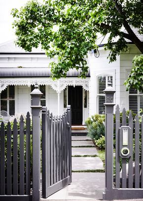 Picket fences are perfect for heritage homes, and can be modernised with a coat of grey paint. Photography: Derek Swalwell