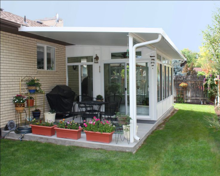 Sunroom With Extended Roof Life For The Home