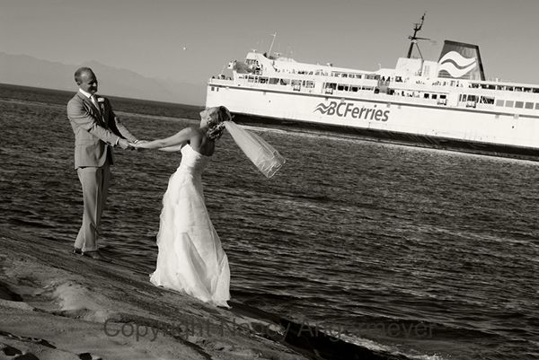 Wedding couple holding hands married on galiano with bc ferry passing by