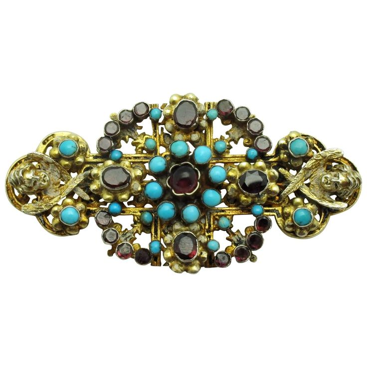 Austro-Hungarian Turquoise Garnet Gilt Silver Brooch | Beautifully detailed mid 19th century brooch set with cabochon turquoise and faceted garnets in a gilded silver. 1stdibs.com
