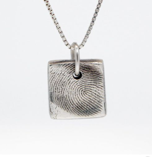 We found an artist who makes really beautiful custom thumbprint jewelry. Lovely keepsake.