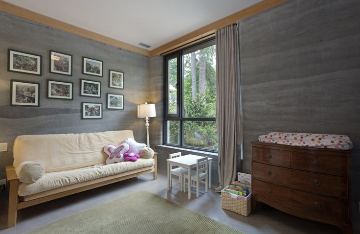 One of the 5 bedrooms - kids room - highlighting rammed earth features and the open and airy daylighting.