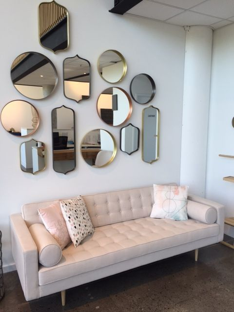 A cluster of mirrors create a gallery effect in our Sydney Showroom in Alexandria.