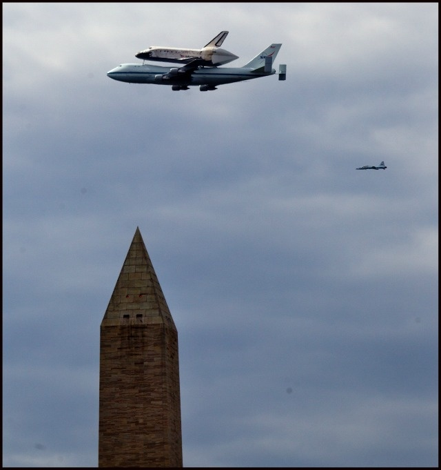 Space Shuttle Discovery flying over DC