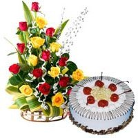 Roses with cake - A perfect combination of a mixed Rose arrangement and a delicious cake, which will surely bring that smile on the face of your loved ones.