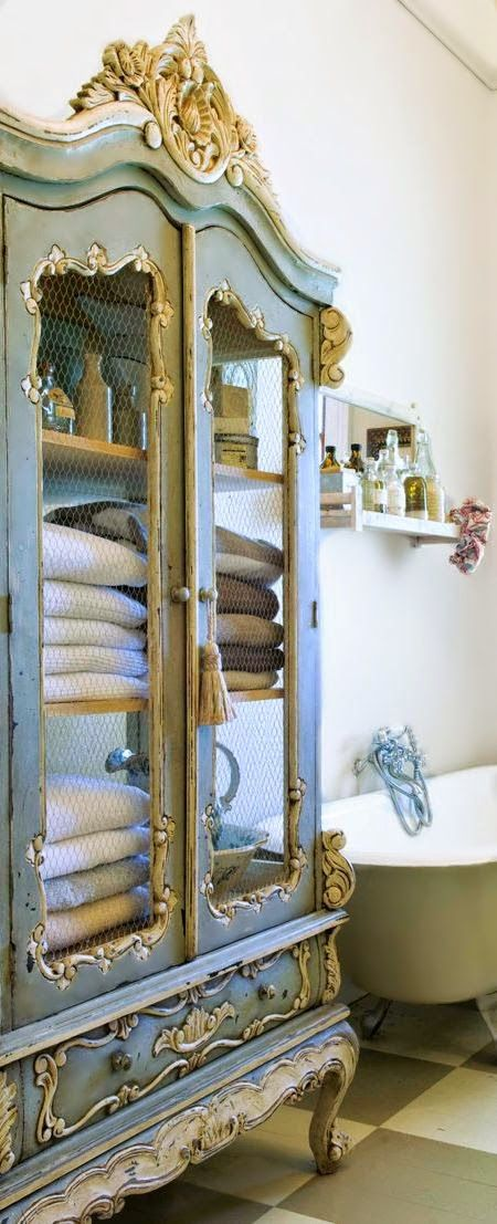 Store your towels & linens in an antique cabinet.