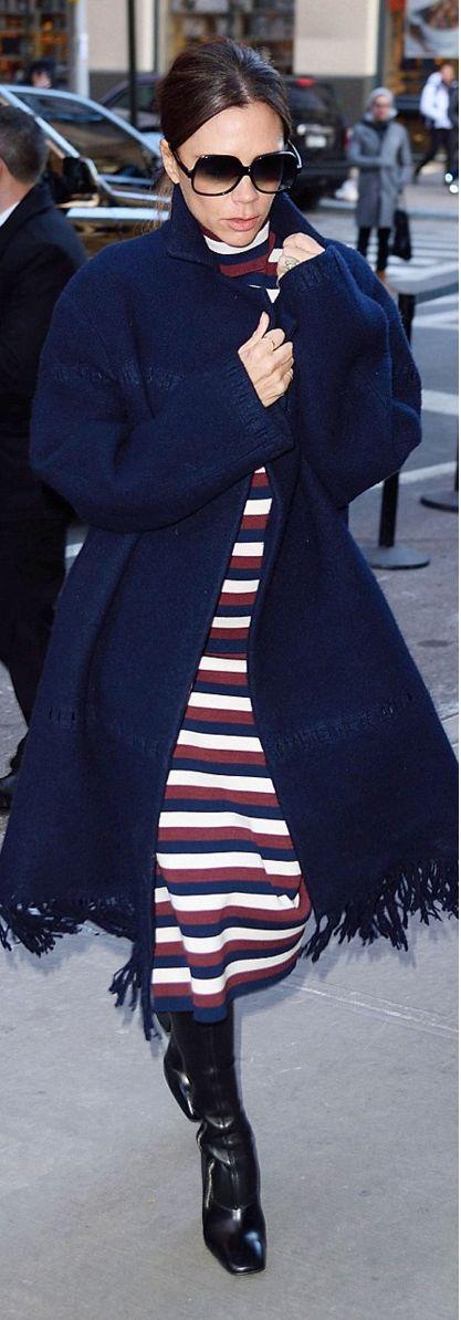 Who made Victoria Beckham's black sunglasses, blue fringe coat, and red stripe dress?