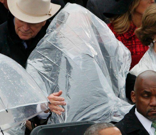 George W. Bush struggles with his rain poncho at Trump's inaugaration, 1/20/17