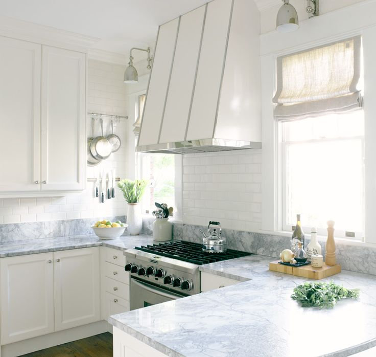 Stainless Steel banding on hood and super white granite countertops replace marble to keep costs down and for durability
