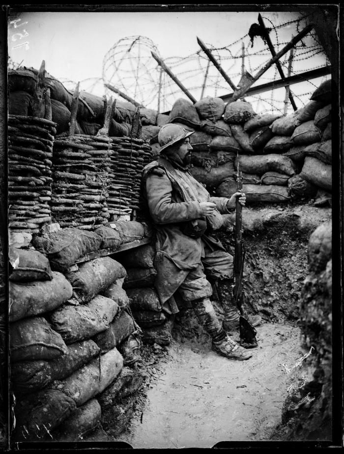 WWI, 1916. Sentry in a little advanced post in the Champagne region, by Jacques Moreau, photographer of the French Army. Credit Bridgeman images.