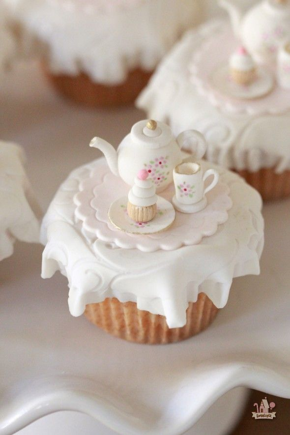 """Vanilla Pumpkin Spice Cupcakes (Sweetopia). """"Easy to make and perfect for fall (and a tea party, in this case)."""" Soooo cute."""