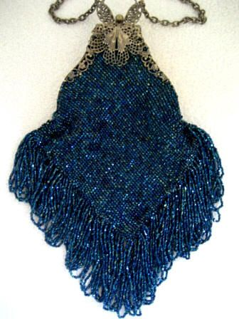 A charismatic and fashionable antique glass knit beaded purse, with a butterfly frame, from the very early 1900's.