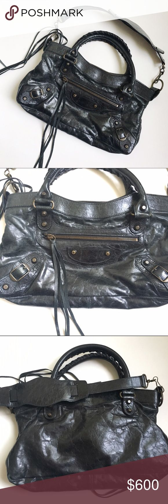"""Balenciaga """"First"""" Leather Shoulder Bag AUTHENTIC. Gently used. Leather is buttery soft with no signs of wear. Clean interior. No stains. Tassles, zipped pockets on outside/inside, & removable shoulder strap (not a crossbody) Color is like a crackled black. Serial numbers indicate it is from F/W 2006, style 103208. Similar to City bag, but I believe its smaller.  13.5"""" x 7.5"""" x 2.6""""  So sad to part with it but it needs a new home! No mirror. Open to reasonable offers. Balenciaga Bags…"""