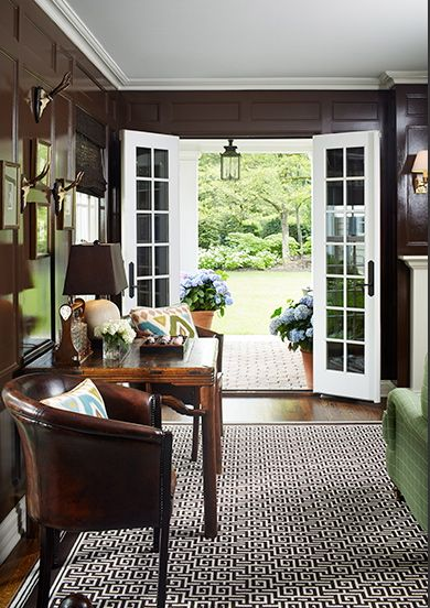 Foyer ~ Glossy chocolate paneled walls & great graphic greek key rug as well.