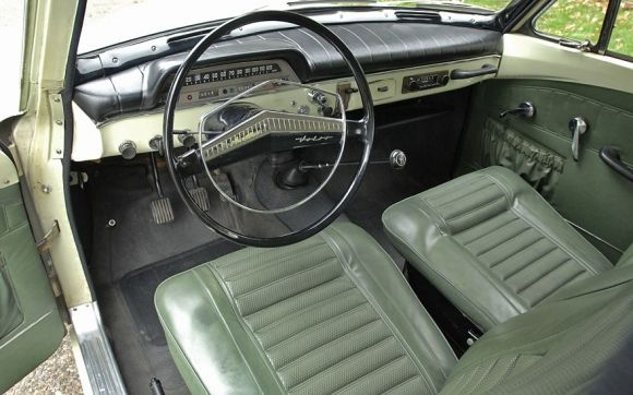 """1966 Volvo 122S For Sale Interior. I'm pretty sure that is not the original upholstery on the seats. It appears to be a yellowed with age """"pearl white"""" version. I think the upholstery in those were red leatherette, but might have been black depending on the year."""