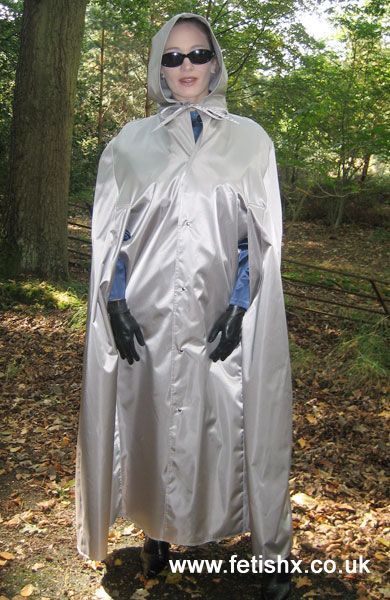Silver rubberized satin cape, hooded, gloved and booted - well prepared for any storm!