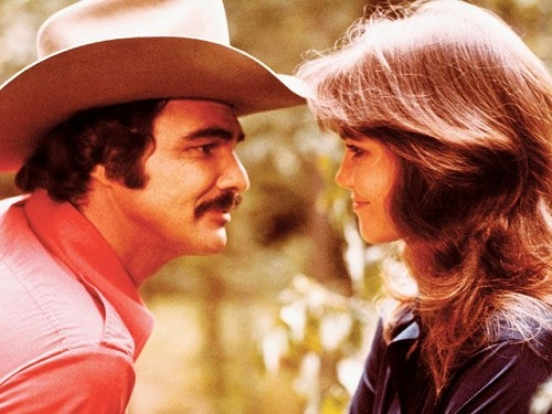 "Carrie (Sally Field): ""Don't you ever take off that stupid hat?"" // Bandit (Burt Reynolds): ""I take my hat off for one thing, one thing only."" -- from Smokey And The Bandit (1977) directed by Hal Needham"