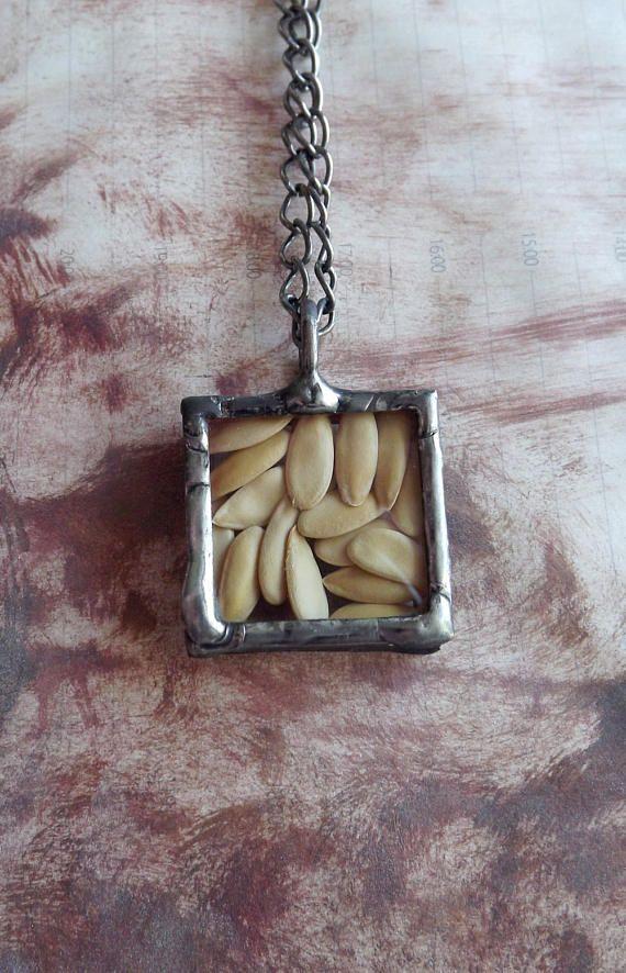 Square pendant with dried melon pips. Original pendant.