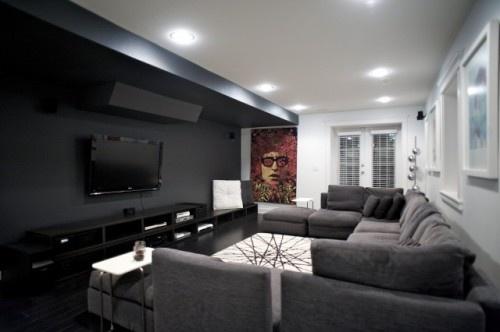 dark wall / grey floors family media room ideas. But tile floors.