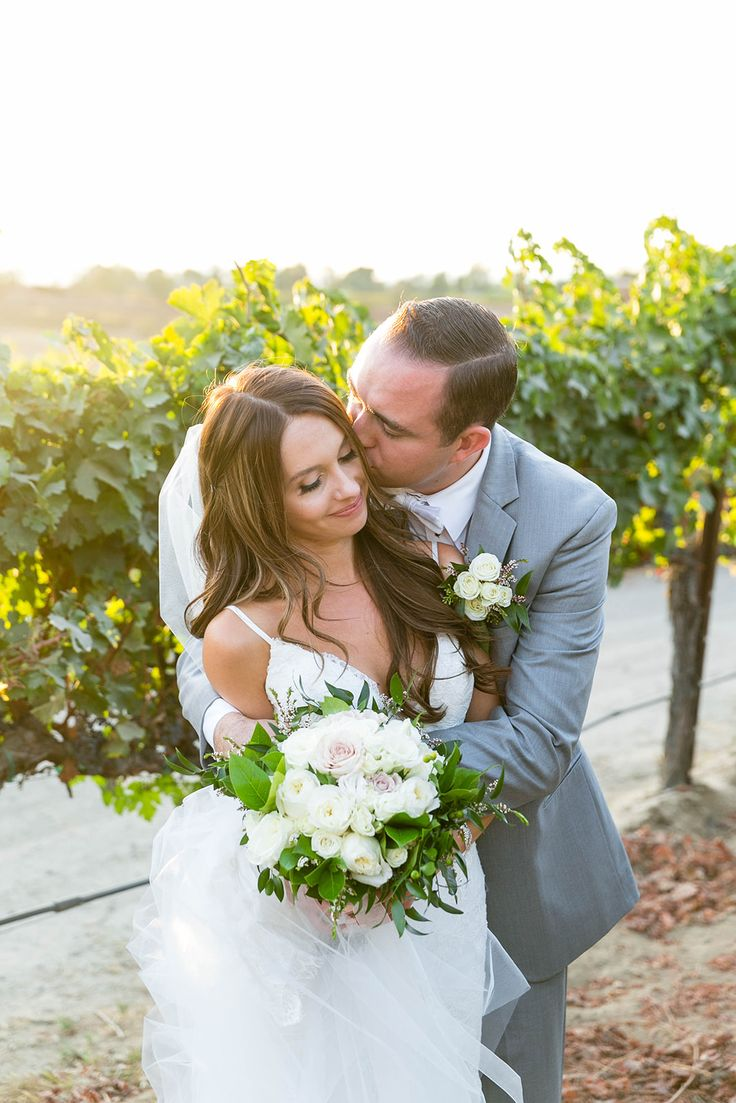 Bride and groom pose at winery wedding Lorimar Winery in