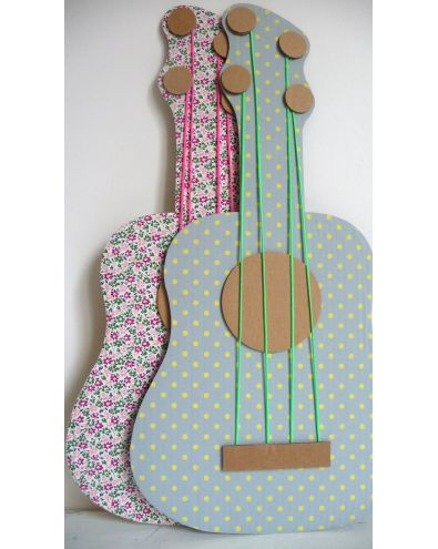 Cardboard guitar... made this tonite for Lyla & her little friend to try out tomorrow! hot glued some cute fabric to a cardboard guitar cut out. pretty cute, we'll see how she likes it. :)