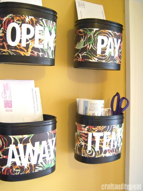 Upcycled formula containers into a mail center from craftandrepeat - would love to see this with glitter or bedazzled or cute patterns! right by the door, in love!