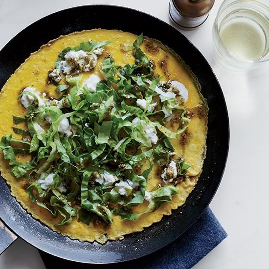 Open-Face Omelets with Spicy Feta and Escarole | Chef Ana Sortun is a vegetable genius. Here, she tops her superfast, Middle Eastern-style omelets with a delicious mix of escarole and feta that's been seasoned with scallion and jalapeño.
